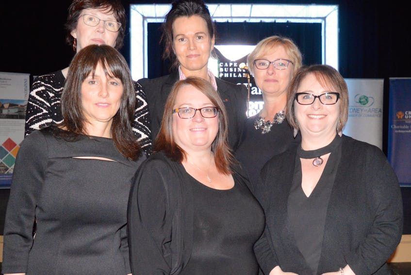 Members of 100 Women Who Care CBRM, front from left, Shelley Bennett Trifos, Shelley Lund and Deana Lloy, and back from left, Margie Moore, Dianne Beauchesne and Rose Westbury pose for a photo at the Cape Breton Business and Philanthropy Hall of Fame dinner and awards in May 2017. The group, which has donated more than $150,000 to a dozen local charities, won the group or event of the year award at the gala.
