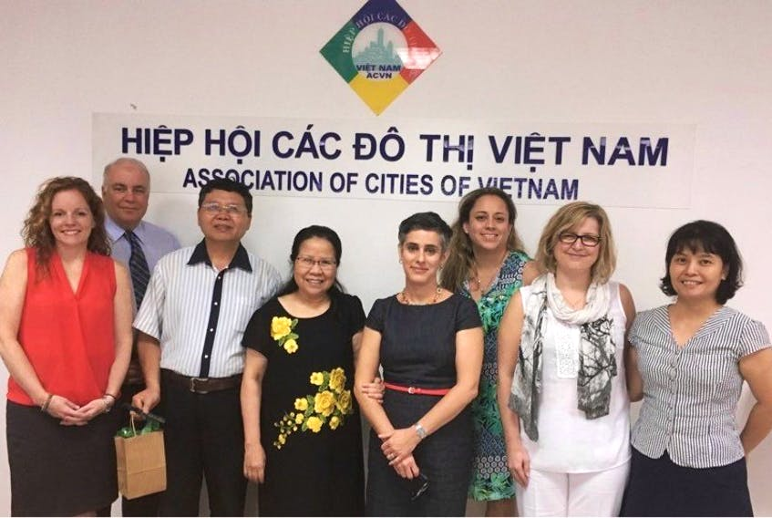 Canadian officials stand with their Vietnamese counterparts in Vietnam after agreeing on a four-year plan to increase economic growth in the country. From left, Carla Arsenault, Bruce Morrison, unnamed researcher with the Association of Cities of Vietnam (ACVN); Nguyen Tho Kim Son, Kristin Marinacci, Perla MacLeod, Brenda Chisholm-Beaton andThi Phuong Thao.
