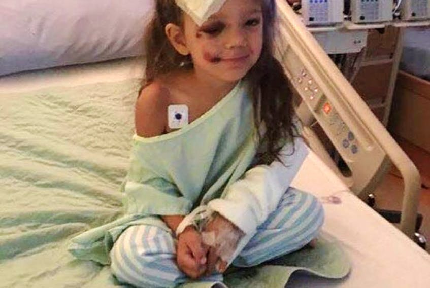 Brielle Marsman, 3, is lucky to survive a two-storey fall from the window of her uncle's house in Calgary.