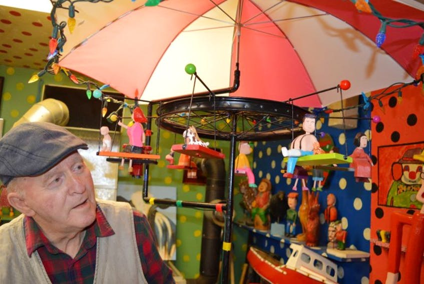Murray Gallant, 78, of New Waterford shows the unique carousel he carved which will be accepted by the Art Gallery of Nova Scotia in Halifax next week. This will result in Gallant now having a total of 16 pieces of his art on display at the museum. Gallant said he not only loves to carve but enjoys putting humour in his pieces, shown by everything from a pig licking an ice-cream cone, to man in a cast sitting with his cat on the carousel.