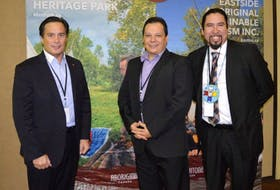 Aboriginal Tourism Association of Canada president and CEO Keith Henry, left, Wagmatcook business owner and ATAC Nova Scotia secretary Robert Bernard, and Jeff Ward, general manager of Membertou Heritage Park, take a picture break during the opening day of discussions at the International Aboriginal Tourism Conference taking place at the Membertou Trade and Convention Centre.