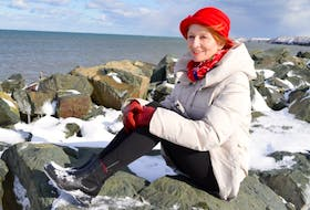 Angie Willems of Scotchtown relaxes at Dominion Beach, a favourite spot for her and former husband David Jowers of Haverhill, England, during a recent trip he made to Cape Breton to visit her. After being separated for more than 40 years the couple reunited after a chance meeting in a coffee shop and Willems is preparing to move back to England to marry him for a second time.