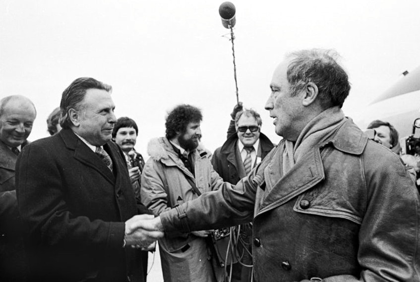 Federal cabinet minister and Cape Breton Highlands-Canso Liberal MP Allan J. MacEachen, left, greets then-prime minister Pierre Trudeau at the Sydney airport in April 1974. MacEachen, who became the country's first deputy prime minister in 1977, died Tuesday at the age of 96.