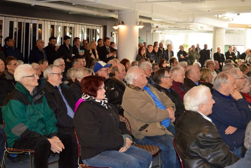 Interested onlookers, municipal officials and local business people crowded into the Joan Harriss Cruise Pavilion in Sydney Monday as the long-anticipated announcement of federal and provincial dollars for a second cruise ship berth for the port of Sydney was announced.