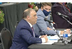 CBRM solicitor Demetri Kachafanas, left, addresses municipal council on Tuesday while planning director Michael Ruus looks on. Kachafanas was discussing the municipality's position on an outstanding freedom of information request about Port of Sydney development. DAVID JALA • CAPE BRETON POST