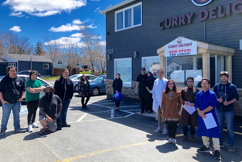 The people who contributed to delivering 150 meals on Sunday stand physically distant outside Curry Delight in Mount Pearl. From left to right: Volunteers Declan Hai and Finley Hai; Organizer Hasan Hai; Volunteers Kadin Hai, Alisa Cutler and Tanisha Furlong; Curry Delight co-owners Muhammad Nasir and Afiya Altaf; Members of the NL Eats team: Shourov Islam, Mehnaz Tabassum, Saif Ahmed, Adib Rahman and Mehdi Khan. -JUANITA MERCER/THE TELEGRAM