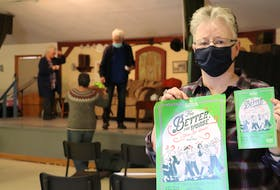 Mary Ellen Callaghan holds the poster and play book for the Benevolent Irish Society's St. Patrick's Day play, For Better, For Worse, by Jimmy Keary.