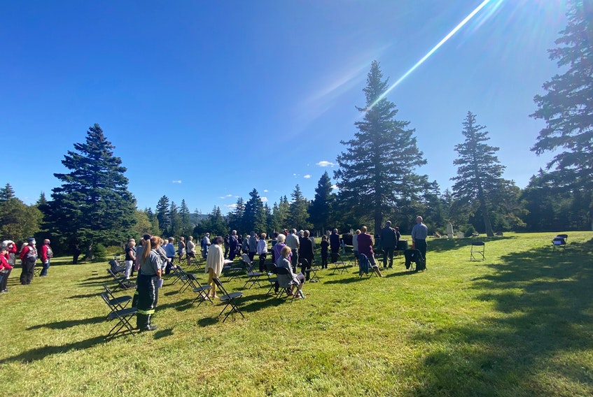 A small crowd gathered at North Side Cemetery in Holyrood to celebrate the restoration of a gravesite for Capt. Thomas Dwyer, a veteran of the First World War. - Submitted photo