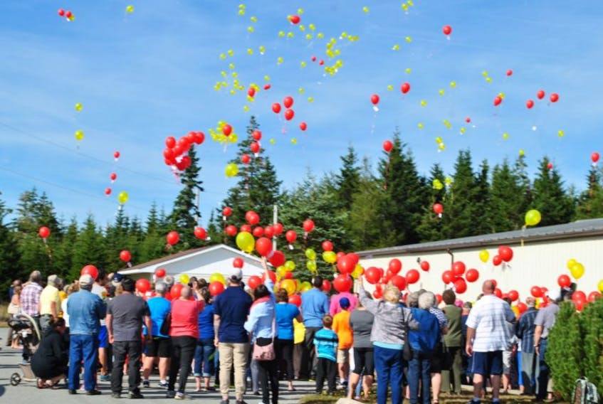 Yellow and red balloons are released at last year's Walk for a Cause.