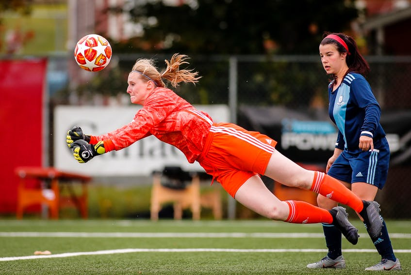 Feildians goalkeeper Sydney Walsh punches out the ball as teammate Chantel Armstrong looks on during the bronze-medal game of the Toyota Jubilee Trophy national women's soccer championship in 2019. Delayed by COVID-19, Jubilee Trophy and Challenge Cup soccer is expected to start up at the end of the month. — NLSA photo/Trevor Wragg