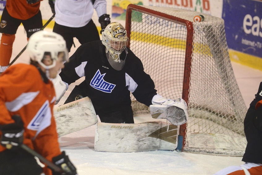 Goalie Colten Ellis follows the play during a Charlottetown Islanders practice earlier this week.
