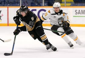 Charlottetown's Lukas Cormier wheels away from Cape Breton's Liam Kidney during the Islanders 4-2 victory over the Eagles on Saturday at Centre 200 in Sydney. Kidney, a Vegas Golden Knights draft selection, scored twice to help lead the Islanders to the win before 1,119 fans. Mike Sullivan Photo