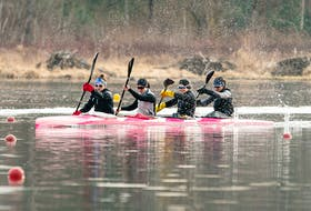 Andreanne Langlois of Trois-Rivieres, Alanna Bray-Lougheed of the Burloak Canoe Club, Cheema's Michelle Russell and Madeline Schmidt of the Rideau Canoe Club race in the K-4 500-metre final Friday in Burnaby, B.C. - Rich Lam / Canoe Kayak Canada
