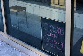 A sign in the window of Jumping Bean on Duckworth Street in St. John's is a variation on one of the many in local shops during the COVID-19 crisis. BARB SWEET/THETELEGRAM
