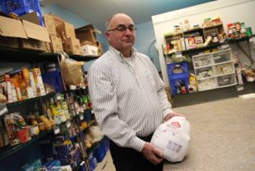 ['Derek Winsor, program director for Bridges to Hope, says there is a need for donations to fill the waiting list for Christmas hampers. — Photo by Rhonda Hayward/The Telegram']