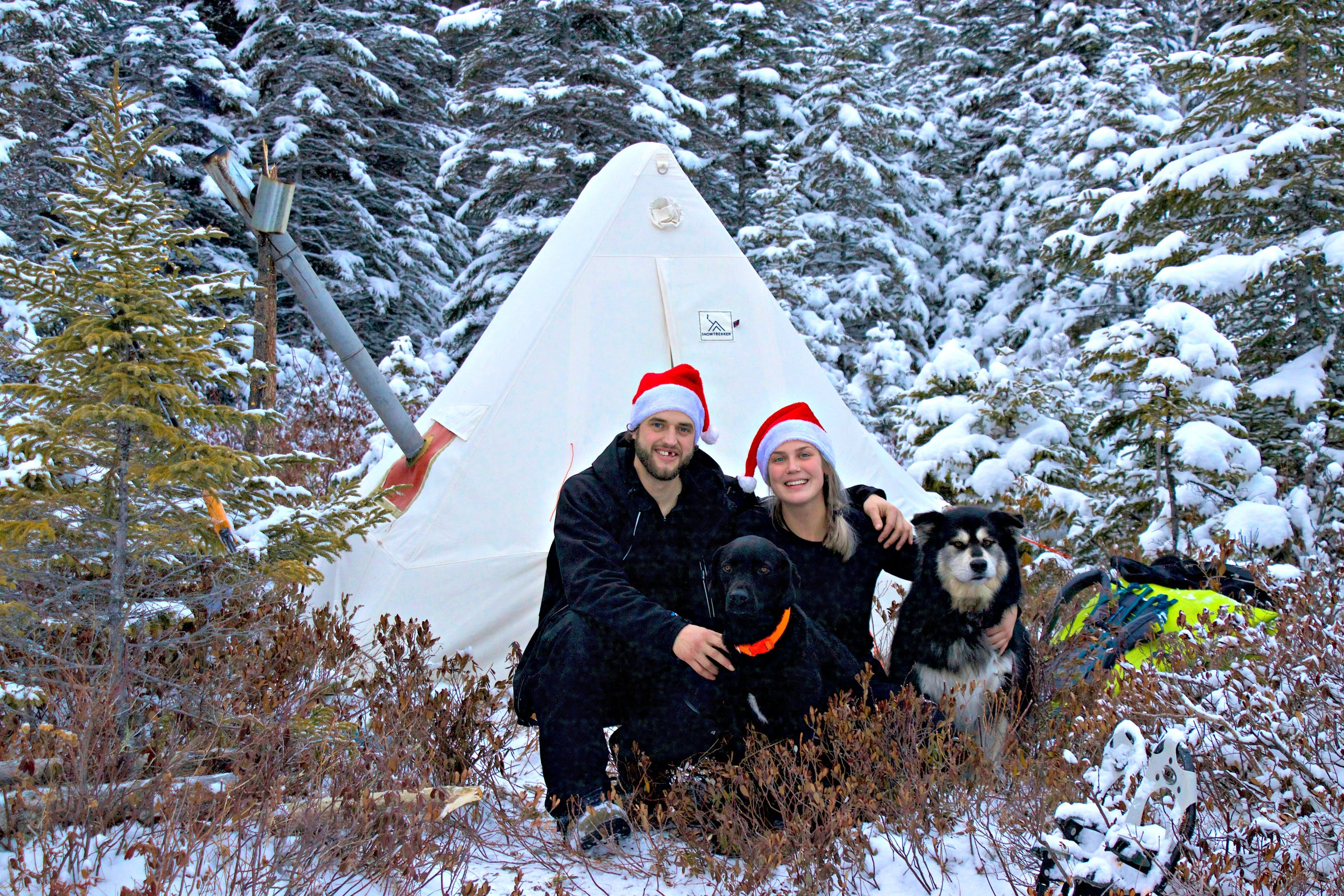 Justin Barbour with his fiancée Heather Oakley and their two dogs, Saku and Bear. Unplugging and reconnecting with nature in the Newfoundland wilderness tops the Christmas gift list for this couple.
