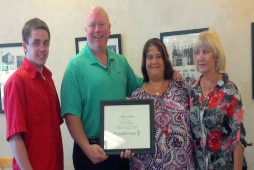 <p>At a recent presentation to Chrysalis House were manager Damon Hubley, left, owner Scott Fraser, Rhonda Fraser, who is executive director of Chrysalis House and volunteer Belinda Manning. - Submitted</p>