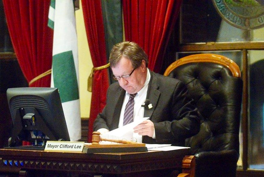 Charlottetown Mayor Clifford Lee looks over some paperwork during the regular meeting of city council Monday night.
