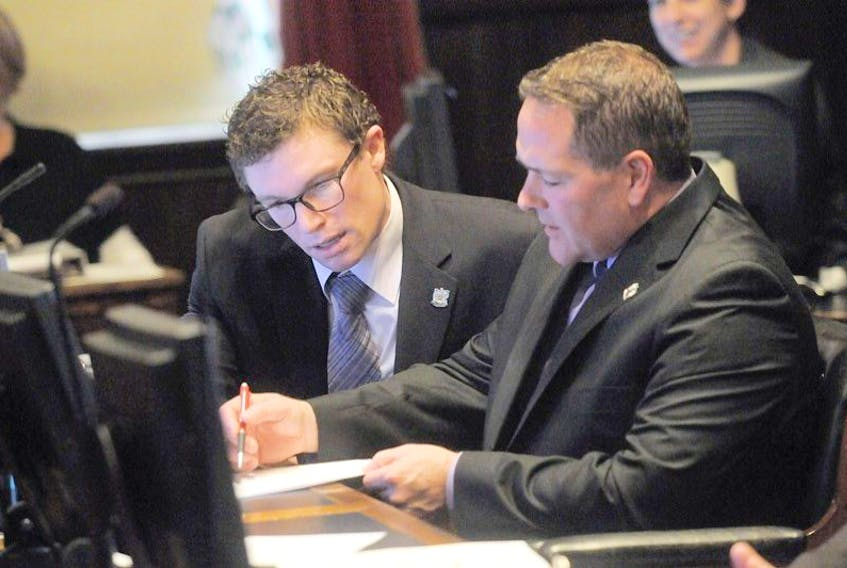 Charlottetown City Councillors Jason Coady, left and Bob Doiron, discuss business Monday before the start of the regular meeteing of council.