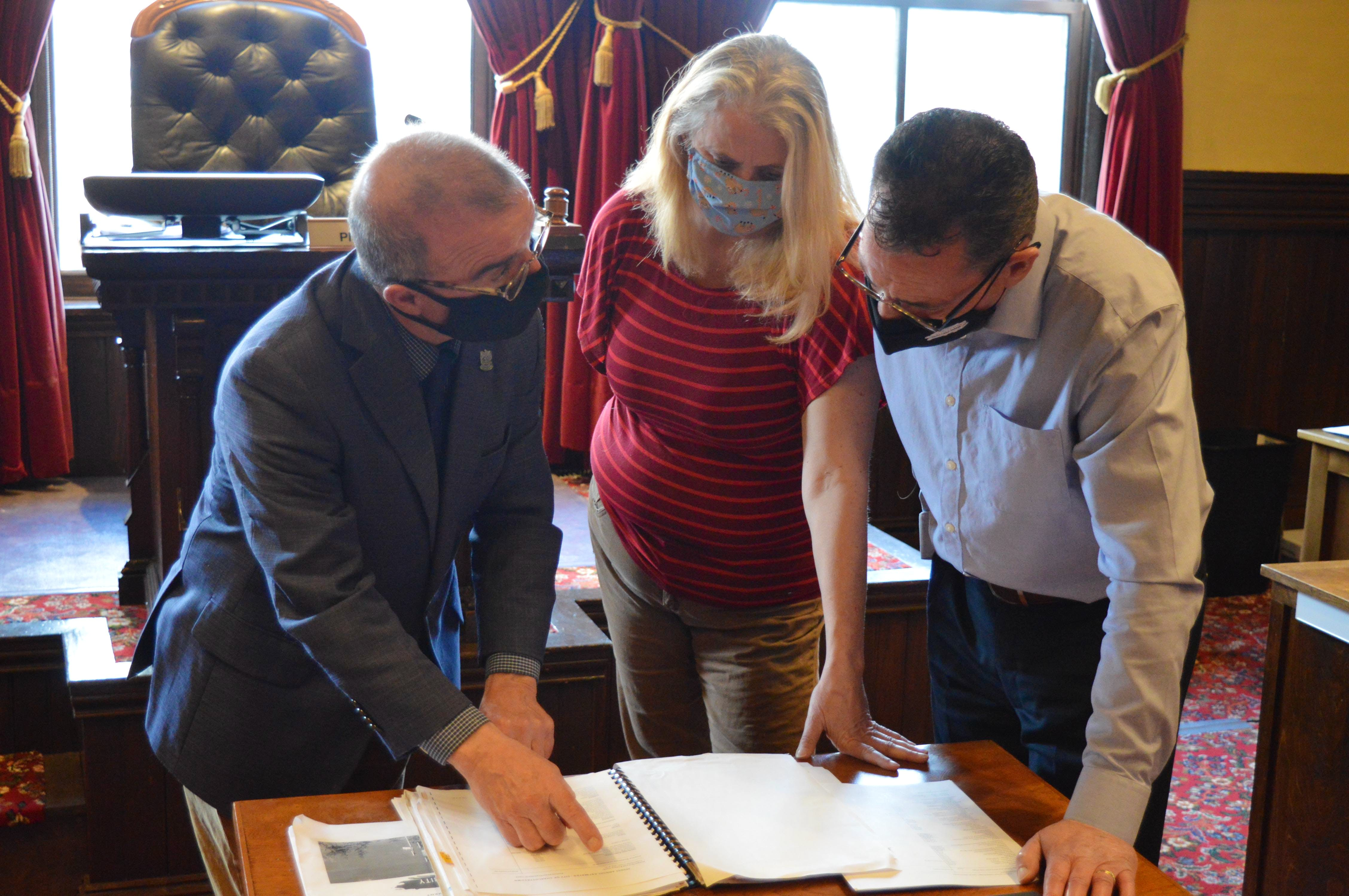 Charlottetown Mayor Philip Brown goes over the 2021-22 capital budget on Monday with Connie McGaugh, accounting clerical clerk; and Stephen Wedlock, controller for the city.