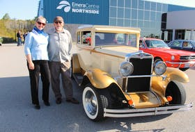 """Classic car enthusiasts Joanne and Gary Knoblett stand next to Gary's 1930 Chevrolet, which he's had for the last 23 years. Joanne has two Mustangs and says they have a """"mixed marriage of Mustangs and Chevys."""" The Glace Bay couple drove in the car parade with hopes it would bring """"smiles to their faces,"""" for both staff and residents of nursing homes. NICOLE SULLIVAN/CAPE BRETON POST"""