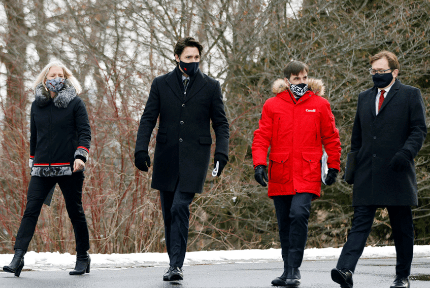 Infrastructure and Communities Minister Catherine McKenna, Prime Minister Justin Trudeau, Canadian Heritage Minister Steven Guilbeault, and Environment and Climate Change Minister Jonathan Wilkinson arrive for a news conference in Ottawa, December 11, 2020.