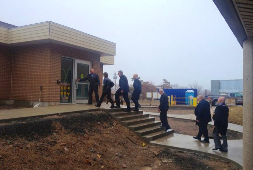 <p>Neil Nichols, chair of the Digby and Area Health Services Charitable Foundation, takes a small group on a quick tour of the Digby and Area Health Services Centre for on April 17.</p>