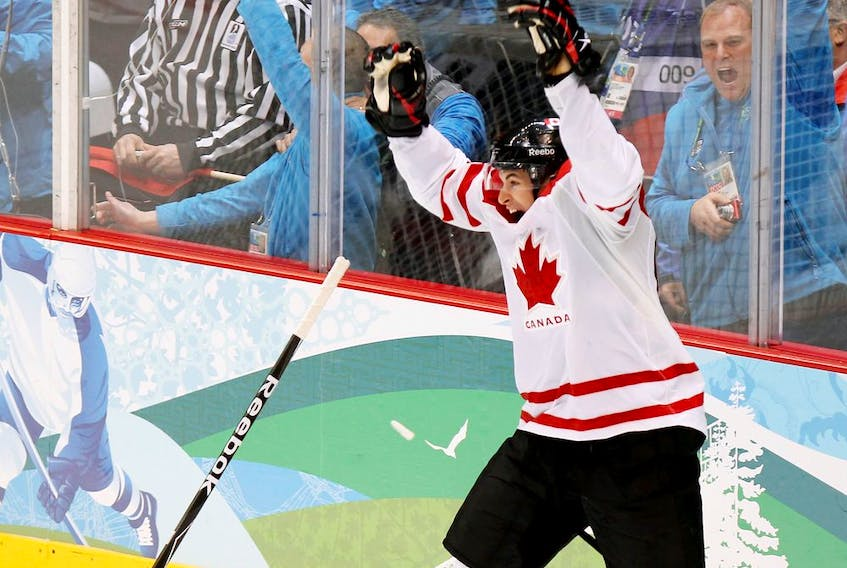 Sidney Crosby celebrates after scoring in overtime to give Canada a 3-2 win over the United States in the gold-medal hockey game at the Olympic Games in Vancouver on Feb. 28, 2010.