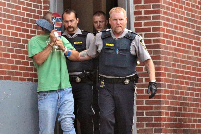 <p>Cody Andrew Prudhomme, 19, pictured here on Sept. 22, 2014 leaving the Hants County Courthouse, is now out on bail. He has been charged with assault with a weapon, failing to stop for police, resisting arrest and dangerous driving in relation to an RCMP officer being run over in Windsor on Sept. 20.</p>