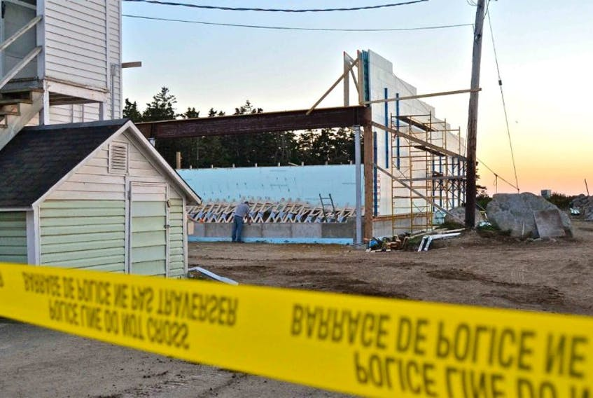Police tape marks off the area of a building collapse near the Newellton Wharf Thursday night.
