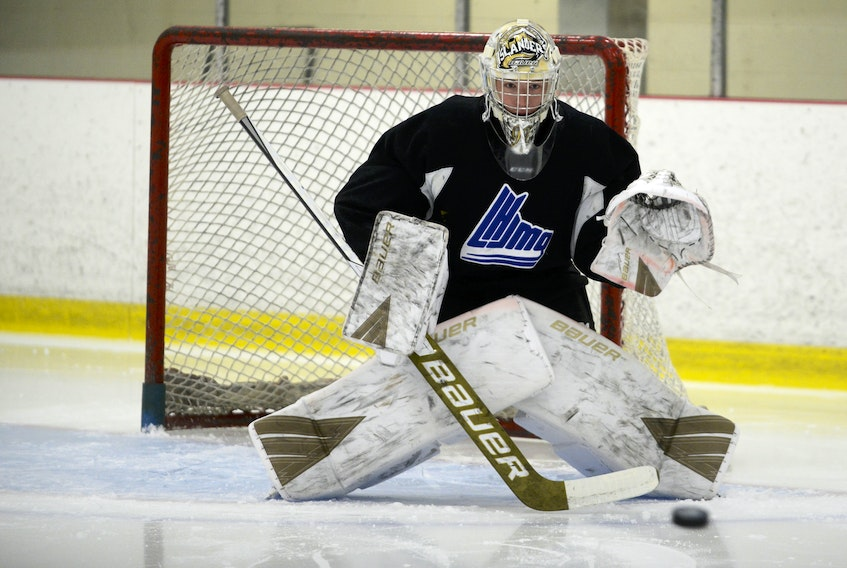Goalie Colten Ellis tracks a shot during Tuesday's Charlottetown Islanders' practice at MacLauchlan Arena.