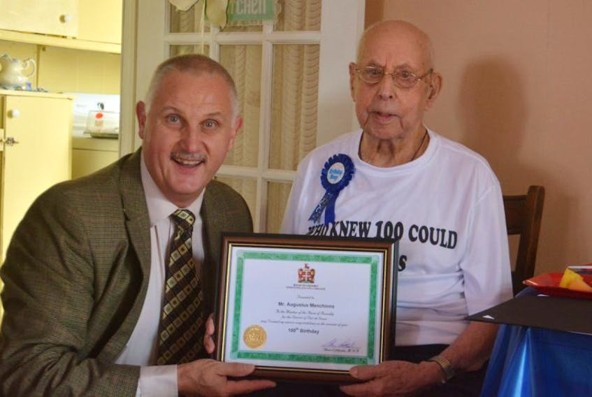 Spaniard's Bay resident Augustus Menchions (right) turned 100 last week. Here he is pictured with Port de Grave MHA Glenn Littlejohn, who gave the new centenerian a framed certificate.