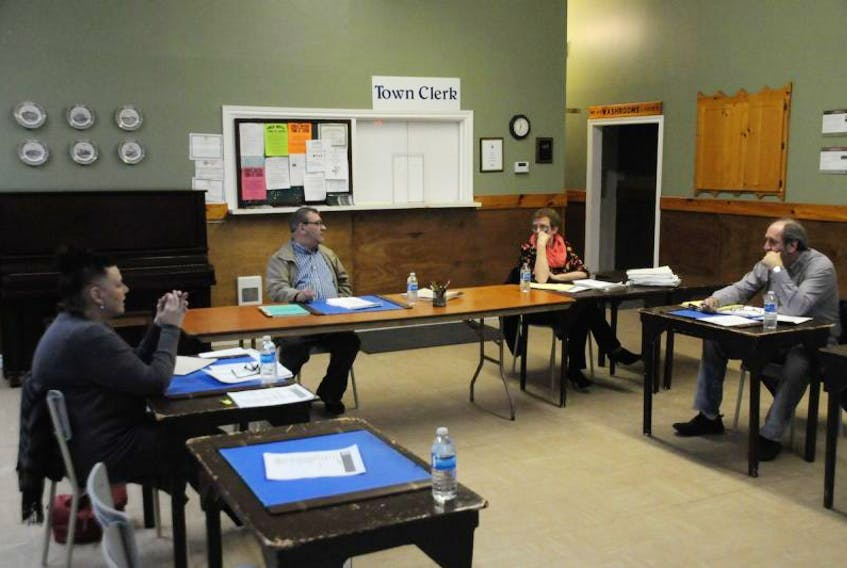 Cupids council will likely make a second attempt May 2 to hold its first meeting since the provincial government appointed two new councillors. Pictured, from the left, is Coun. Joanne Wells, Acting Mayor Gordon Power, town clerk Ivy King and Coun. Rod Delaney at the community centre on April 11.