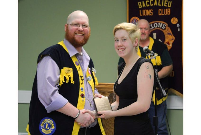 Kian Dove (right) received her award from Mike Foote of the Baccalieu Lions Club.