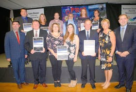 Award winners pose with Tourism Minister Christopher Michelmore, far left, and Placentia West-Bellevue MHA Mark Browne, far right. Top row (l-r) former Placentia mayor Wayne Power Jr., Elizabeth Collins (Sedna Nutraceutical/Ironberry), Gerry Sullivan (Spence Corrosion Canada), Dan Culleton and Tiffany Hepditch (Placentia Area Development Association) and Wendy Leonard (RBC Placentia). Bottom row (l-r) Dan Meade (Dandy Dan's Seafoods), Sherry Keefe and Amanda O'Reilly (Devine Décor) and Headley Burge and Cathy O'Keefe (Argentia Freezers & Terminals Ltd.).