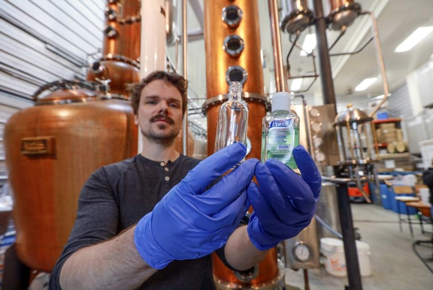 Alex Wrathell, with Compass Distillery in Halifax, and his staff are currently making sanitizer.