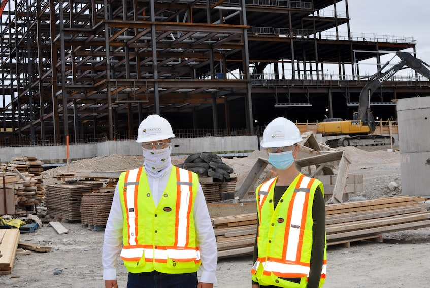 Charles Gunning (left) senior project manager with PCL/Marco on the new hospital build in Corner Brook and co-op student Kate Tucker took SaltWire Network on a tour of the facility on Tuesday. — Diane Crocker/SaltWire Network