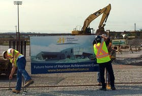 In preparation for a picture with the assembled dignitaries, workers erect a sign declaring the new site for the Horizon Achievement Centre. Construction has begun on the $7 million facility located in the Sydney's Harbourside Commercial Park. CAPE BRETON POST PHOTO