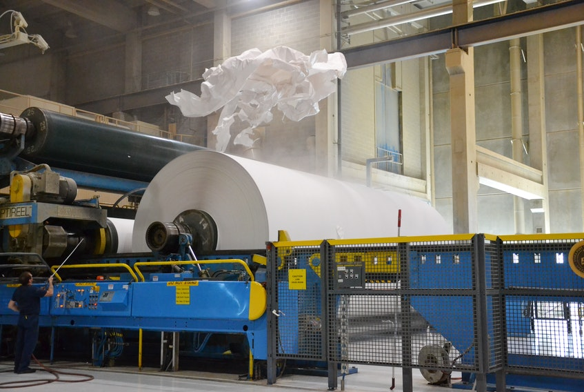 Supercalendered paper comes off a roll at Port Hawkesbury paper in this file photo. NANCY KING/CAPE BRETON POST