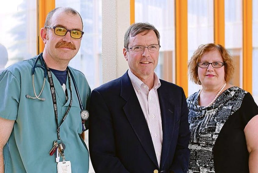 """<span class=""""art-imagetext"""">Delegates gather at the Queen Elizabeth Hospital to launch the I.N.S.P.I.R.E.D. COPD outreach program on P.E.I. From left are Wade Norquay, respiratory therapist supervisor, QEH, Dr. Graeme Rocker, medical director, I.N.S.P.I.R.E.D. COPD outreach program and Marilyn Barrett, director of primary care and chronic disease at Health P.E.I.</span>"""