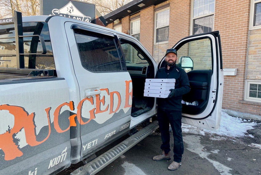 Steve Zahanov, owner of Sorrento in Corner Brook, does a curbside delivery of some of the free meals that have been donated to essential workers in the city.  Contributed