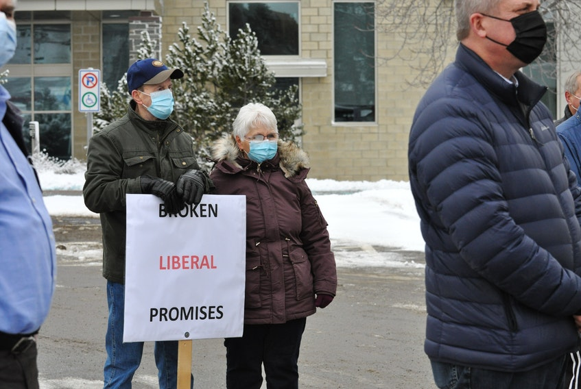 Heber Oldford braved the cold in Corner Brook on Monday to add his voice to a protest calling on the province to make good on a promise to put a PET scanner in the new hospital.