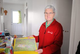 Margaret Hicks displays a picture of a rat caught in a trap she set in the backyard of her home on Concord Avenue in Corner Brook. STEPHEN ROBERTS PHOTO