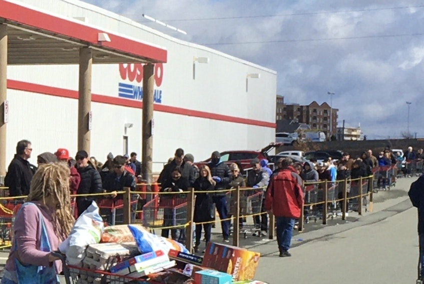 A crowded lineup is seen at the Costco in Bayers Lake on Monday. Similar scenes have been reported up until Wednesday evening in contravention of the COVID-19 social distancing law. - Gordon Delaney