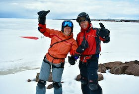 Janice Butler and her husband Allain Albert harnessed Summerside's winter winds while paraskiing over the frozen harbour.