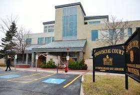 ['Safety fencing is still around the Corner Brook Law Courts as the provincial government tries to work with the contractor that designed and installed the roof.']