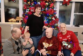 Shelia Lane, standing, of Middle Cove is finding grieving the loss of her father is a different experience during the COVID-19 pandemic. Her family, from left, husband Ryan Lane, son George, father Lindsay Tulk and mother Sylvia Tulk are seen in a picture taken during a Christmas celebration.  Contributed