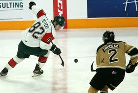 Belgian forward Senna Peeters, left, will return for a second season with the Halifax Mooseheads in 2020-21. He is shown during a game against the Charlottetown Islanders at the Scotiabank Centre last season. (TIM KROCHAK/Chronicle Herald)