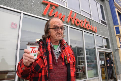 James K. MacFarlane, a north end Charlotte Street resident, is a frequent daily visitor to the Tim Hortons store on Charlotte Street in Sydney. This Tim's location will close permanently at the end of the day on Friday afternoon, the first COVID-19 business casualty in downtown Sydney. CHRIS SHANNON • CAPE BRETON POST