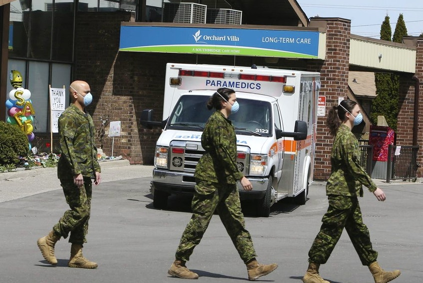 Members of the Canadian Armed Forces in front of Pickering's Orchard Villa long-term care home on Wednesday May 6, 2020.